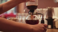 The process of preparing syphone coffee. Baristas hand making syphone coffee Stock Footage