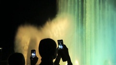 Girl shoots video of Singing Fountainon using smartphone Stock Footage