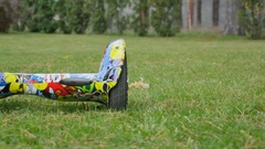 Segways are lying on the grass Stock Footage