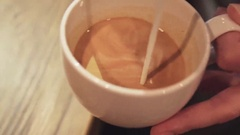 Amazing barista tutorial of making art latte, shape of a swan. Female hands Stock Footage