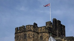 Great Britain England Northumberland British national Flag on Alnwick Castle Stock Footage