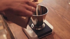 Cafe activities, weighing of roasted coffee beans on the kitchen electronic Stock Footage
