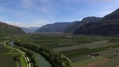 Alp Mountain Aerial over River and green fields Stock Footage