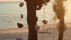 Indonesia Gili Meno windbells shell mobile on the beach at sunset Stock Footage