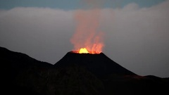 La Reunion Piton de la Fournaise volcano eruption at night with lavaflow Stock Footage