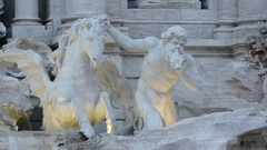 Close up of triton statue at trevi fountain with lights on in rome Stock Footage