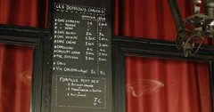Last menu of Bataclan restaurant cafe theater in Paris, France Stock Footage