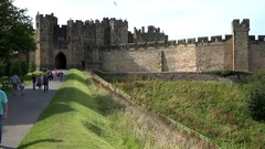 Great Britain England footpath at backside of old Alnwick Castle Stock Footage
