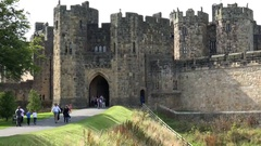 Great Britain England Alnwick sunlight and shadows on old castle walls Stock Footage