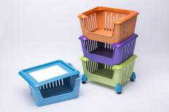 Color plastic basket on white background Stock Photos