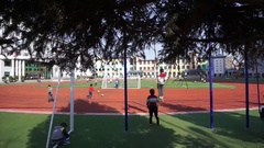 Elementary school students playing on campus Stock Footage