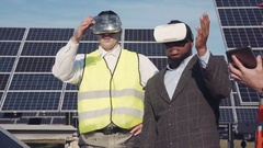 Workman and investor wear virtual reality glasses Stock Footage