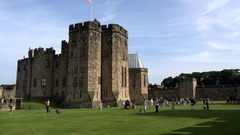 Great Britain England Northumberland Alnwick Castle main building on green lawn Stock Footage
