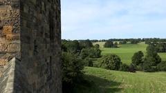 Great Britain England Northumberland Alnwick Castle corner & green landscape Stock Footage