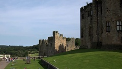 Great Britain England Northumberland Alnwick green lawn behind castle Stock Footage