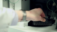Vials Being Placed into a AS-AP Autosampler Chamber Stock Footage