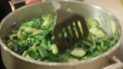 Steaming green vegetables in a pan Stock Footage