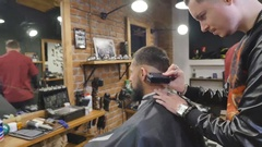 Haircut men Barbershop. Men's Hairdressers; barbers. Barber cuts the client Stock Footage