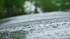 Rain Drops Splashing Onto The Car On A Rainy Day Stock Footage