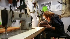 Work on skin, tailor, sewing, needle, purse Stock Footage