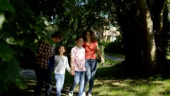 4K Happy family spending time outdoors, going for a walk in the countryside Stock Footage