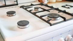 Woman washes a gas stove in cleaning the kitchen Stock Footage