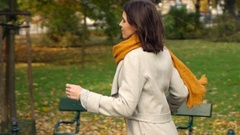 Late woman running in autumn park, super slow motion 240fps Stock Footage