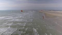 Flying Over Kitesurfers on a Beach Stock Footage