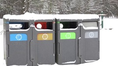 Small bins for rubbish and trash, recycling in winter park. Zoom out. 4K Stock Footage