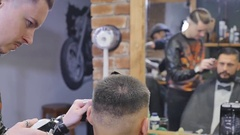 Making hair look magical. Young bearded man getting haircut with straight edge Stock Footage