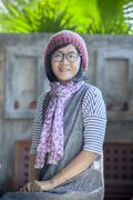Portrait of 40s years asian woman wearing wool hood and silk scarf toothy smi Stock Photos