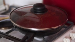 Cooking tomato sauce in a pan with garlic and black pepper, for italian pasta Stock Footage