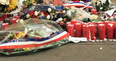 Charlie Hebdo flowers, messages and candles Stock Footage