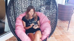Close up of young beautiful woman in black t-shit on hammock at the luxury villa Stock Footage