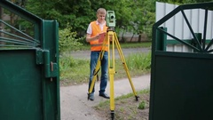 Surveyor at work measuring the distance Stock Footage