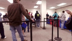 Pan of voters waiting in Toledo Ohio early voting 2016 presidential election Stock Footage