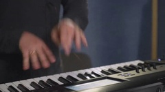Man playing on the synthesizer with touch screen Stock Footage