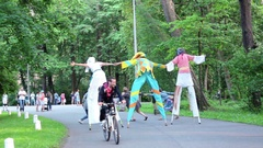 People Taking Best Photos with Funny Very Tall Clowns Stock Footage