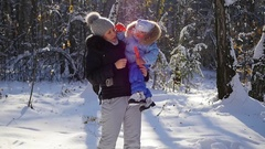 The girl with the boy blow soap bubbles in the winter park Stock Footage