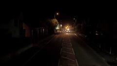 Highways Repair Vehicles Exiting Urban Site at Night Stock Footage