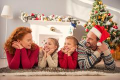 Parents and kids enjoying New Year celebration Stock Photos