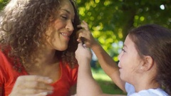 4K Portrait happy affectionate mother & daughter spending time together outdoors Stock Footage