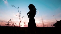 Silhouette of slender girl dance during the sunset Stock Footage