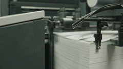 Printing process - feeding sheets of paper, polygraph industry Stock Footage
