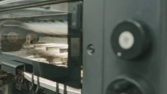 Professional printing machine in action, polygraph industry Stock Footage
