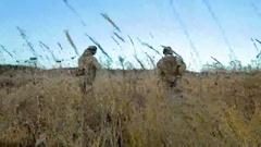 Ukrainian soldier walk on the field Stock Footage