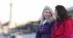 Mature female friends looking out to sea Stock Footage