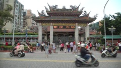 4K Mengjia Longshan Temple in Taipei. Many Buddhist People go to praying -Dan Stock Footage