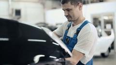 Man repairing car bumper. Stock Footage