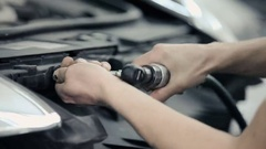 Male hands tightening the bolts in the bumper. Stock Footage